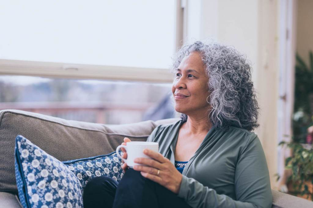 Image of woman with hot drink