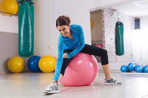 Picture of woman stretching on an exercise ball