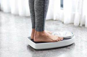Picture of a woman's feet standing on the scale