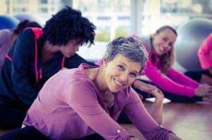 Image of women stretching in an exercise class