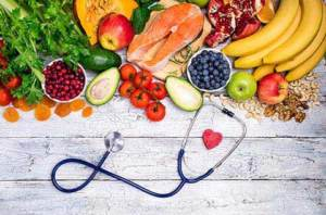 Image of fruits and vegetables with a stethoscope symbolizing healthy eating