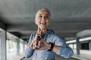 Image of a woman taking her pulse after exercise