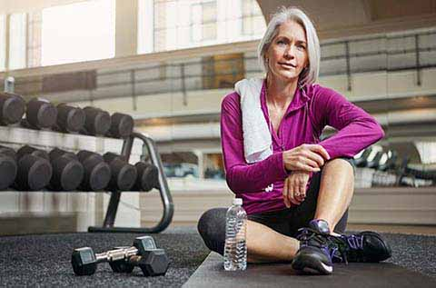 Image of a woman resting on gym floor