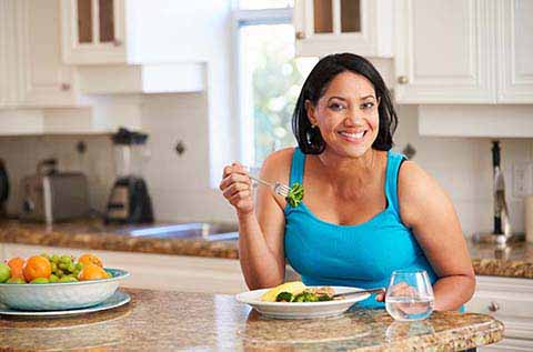 Picture of a woman enjoying her meal