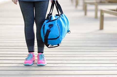 Picture of a woman holding a duffle bag