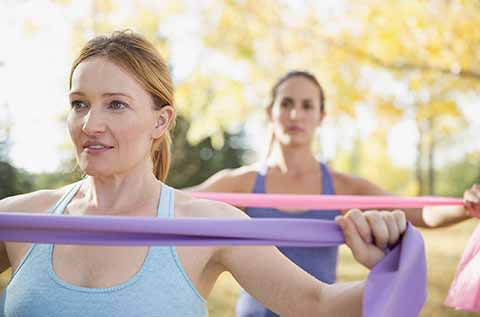 Woman exercising with resistance bands