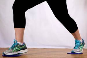 Woman exercising with sliders